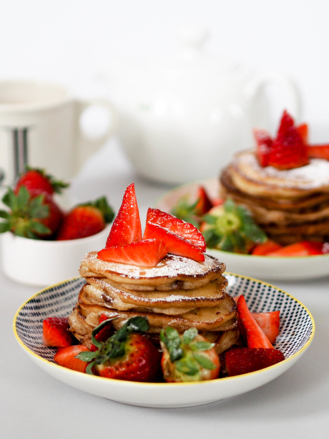 Fluffy American pancakes with chocolate chips and strawberries